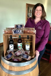 Jen Layton at the bar with fruitcakes and wine at Layton's Chance. The winery will  Flying Fruitcake Fun event on Jan. 27, 2019.