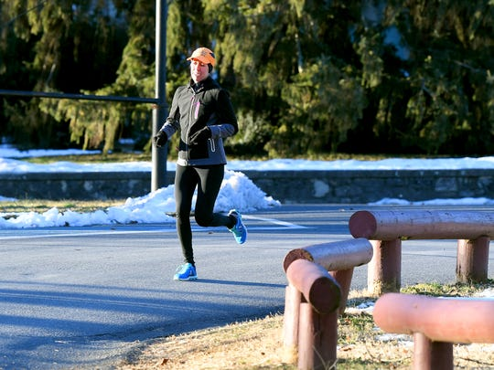 With the temperature around 8 degrees, Jessi Locklear of Staunton runs in the brisk cold around Gypsy Hill Park on Monday morning, Jan. 21, 2019. Locklear runs in all types of weather, regardless of the conditions.