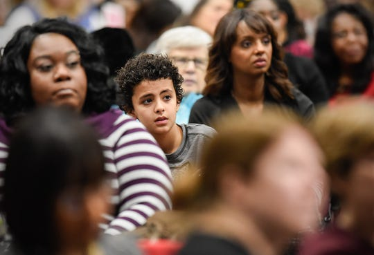 Guests listen to the speakers during the Dr. Martin Luther King Jr. Breakfast and Day of Service Monday, Jan. 21, at the River's Edge Convention Center.