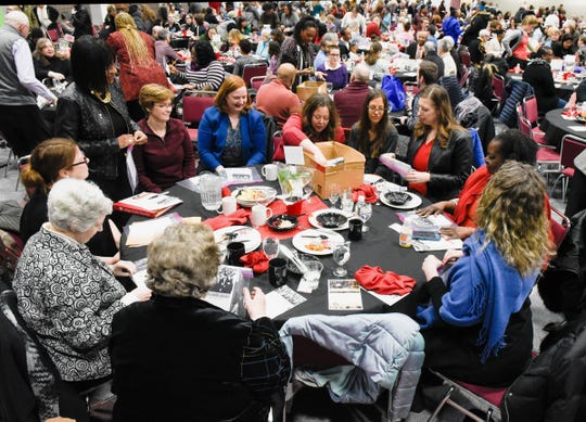 Guests talk during community conversations at the Dr. Martin Luther King Jr. Breakfast and Day of Service Monday, Jan. 21, at the River's Edge Convention Center.