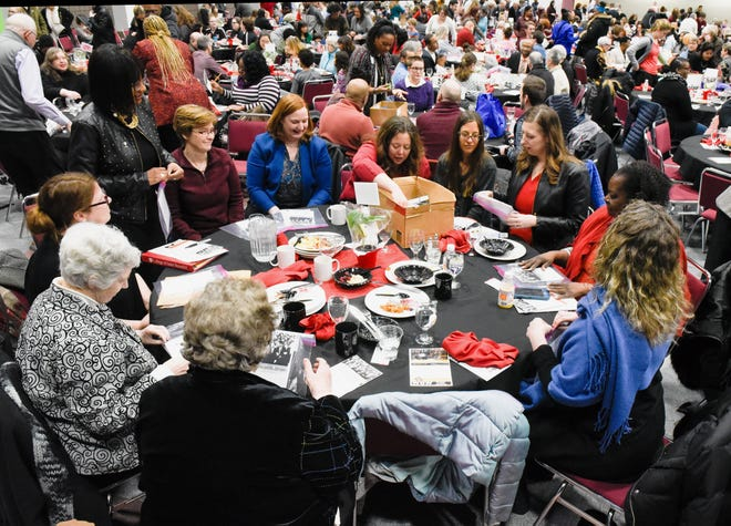 Guests talk during community conversations at the Dr. Martin Luther King Jr. Breakfast and Day of Service Monday, Jan. 21, 2019, at the River's Edge Convention Center.
