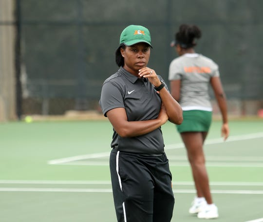 FAMU tennis head coach Nikki Houston (formerly Goldthreate) observes her players during a home match versus Morgan State.