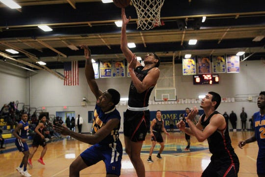 Zimife Nwokeji tries for a tip-in rebounds during Monday's MLK Inspire Classic at Rickards. Competing with The Rock Academy, the former Maclay star and FSU commit scored 13 points and grabbed 12 rebounds.
