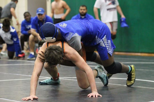 Godby sophomore Julian Green wrestles at the 2019 Trojan Invitational IBT at Lincoln.