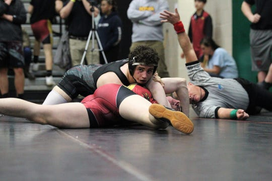 Chiles sophomore Kyle McGill pins an opponent during the 2019 Trojan Invitational IBT at Lincoln.
