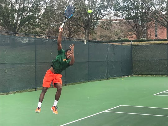 FAMU's Rodney Sturgis goes skyward in prep for his match against Morgan State on Friday, Jan. 18.