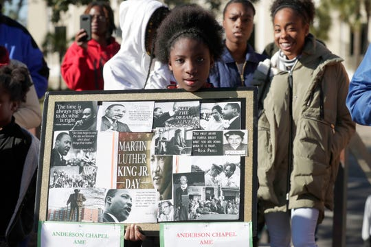 The Tallahassee Branch of the NAACP hosts its annual Rev. C.K. Steele Sr. Commemorative Service and the Rev. Dr. Martin Luther King, Jr. Commemorative Rally, Monday, Jan. 21, 2019. Jayda Roberson, 12, stands in the crowd with her poster dedicated to Dr. Martin Luther King, Jr.