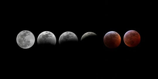 A progression of the super blood moon lunar eclipse at Shell Point Beach, Sunday, Jan. 20, 2019.