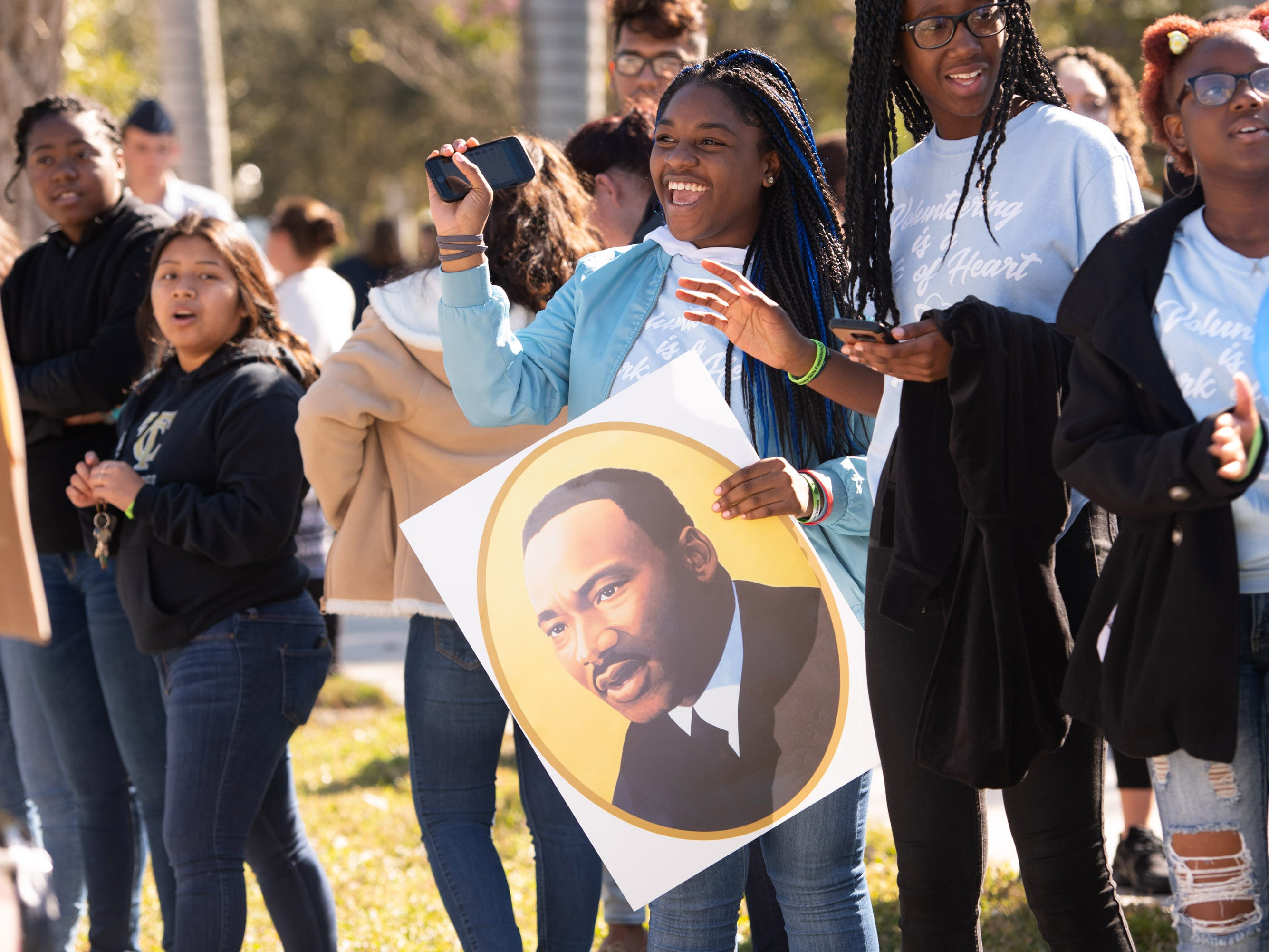 "Leisha Celestin (center), 16, of Port St. Lucie, waves to parade-goers during the Martin Luther King Jr. Day Parade and Celebration along Southeast Martin Luther King Jr. Boulevard on Monday, Jan. 21, 2019, in Stuart. ""Remembering Martin Luther King Jr.'s name is what matters most today,"" Celestin said."
