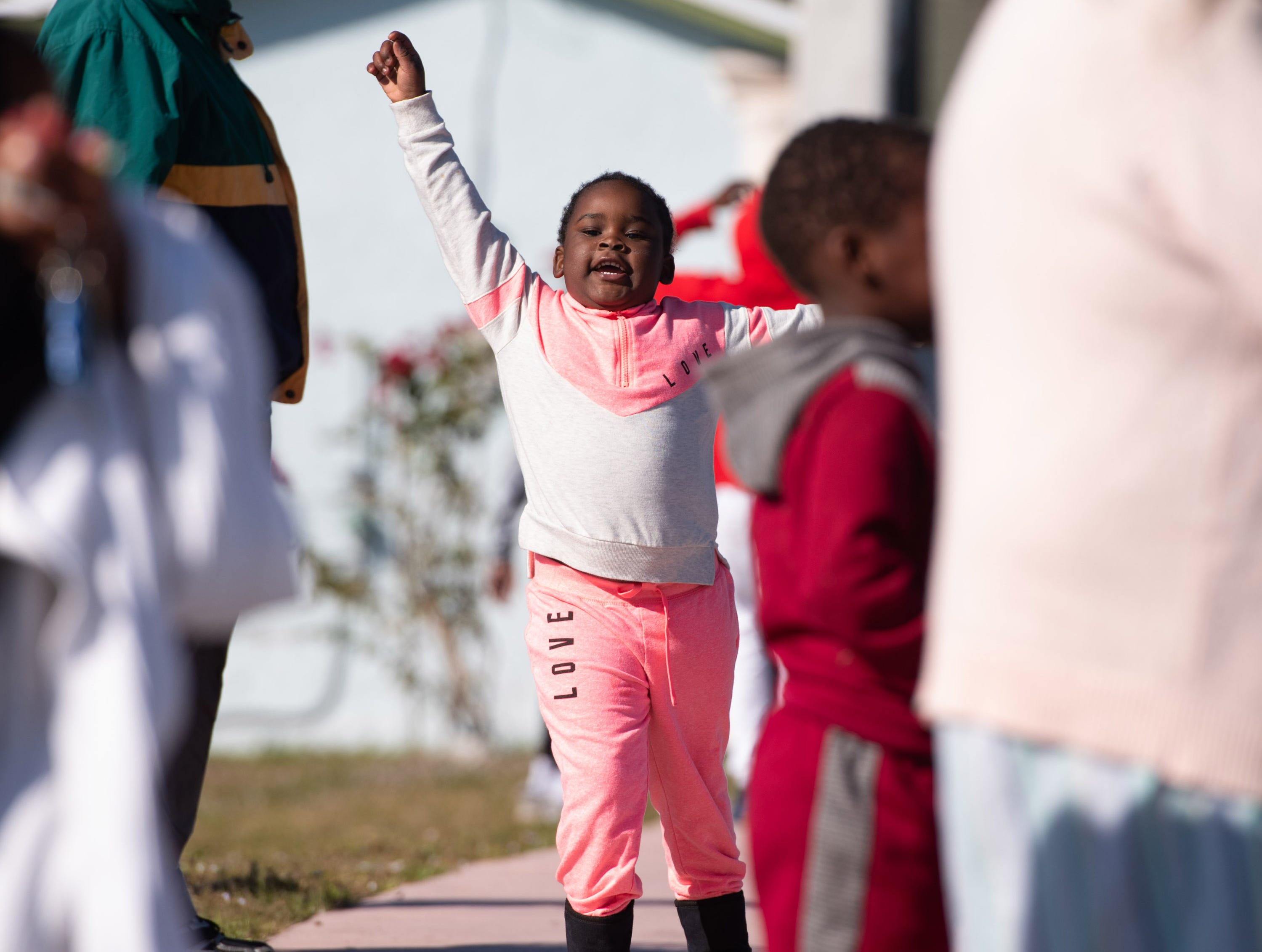 "Kelise Lott, 4, of Stuart, celebrates with other parade-goers during the Martin Luther King Jr. Day Parade and Celebration along Southeast Martin Luther King Jr. Boulevard on Monday, Jan. 21, 2019, in Stuart. ""I am here to support Martin Luther King,"" Lott said."