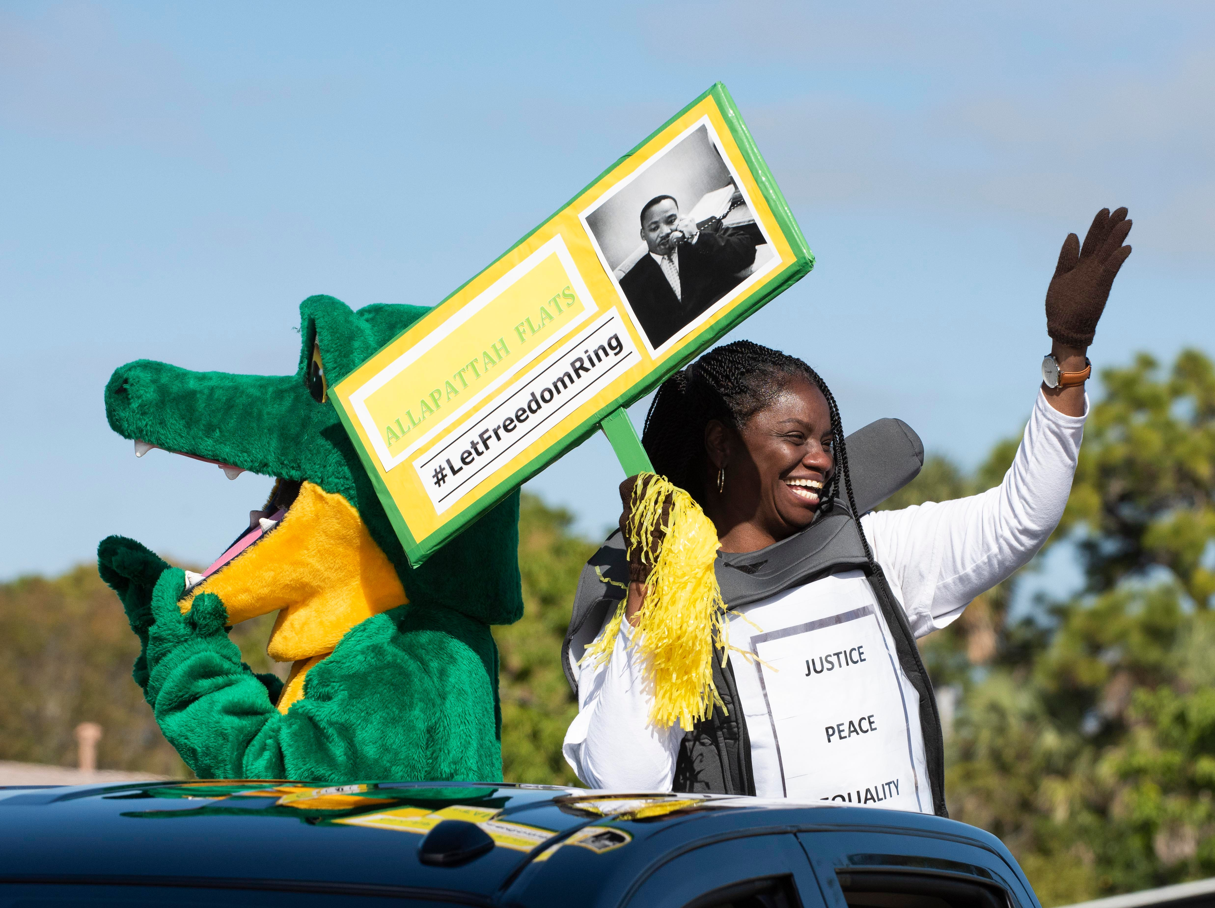 """""""Peace, love and equality. We all need all of those things,"""" said Dorothy Hambrick, a teacher from Allapattah Flats K-8, who rides in the annual Dr. Martin Luther King Jr. Grand Parade on Monday, Jan. 21, 2019, in Fort Pierce. The parade began at Avenue I and Dr. Martin Luther King Boulevard and ended at Lawnwood Stadium. The theme of this year's parade was """"A Legacy of Justice, Peace and Equality."""""""