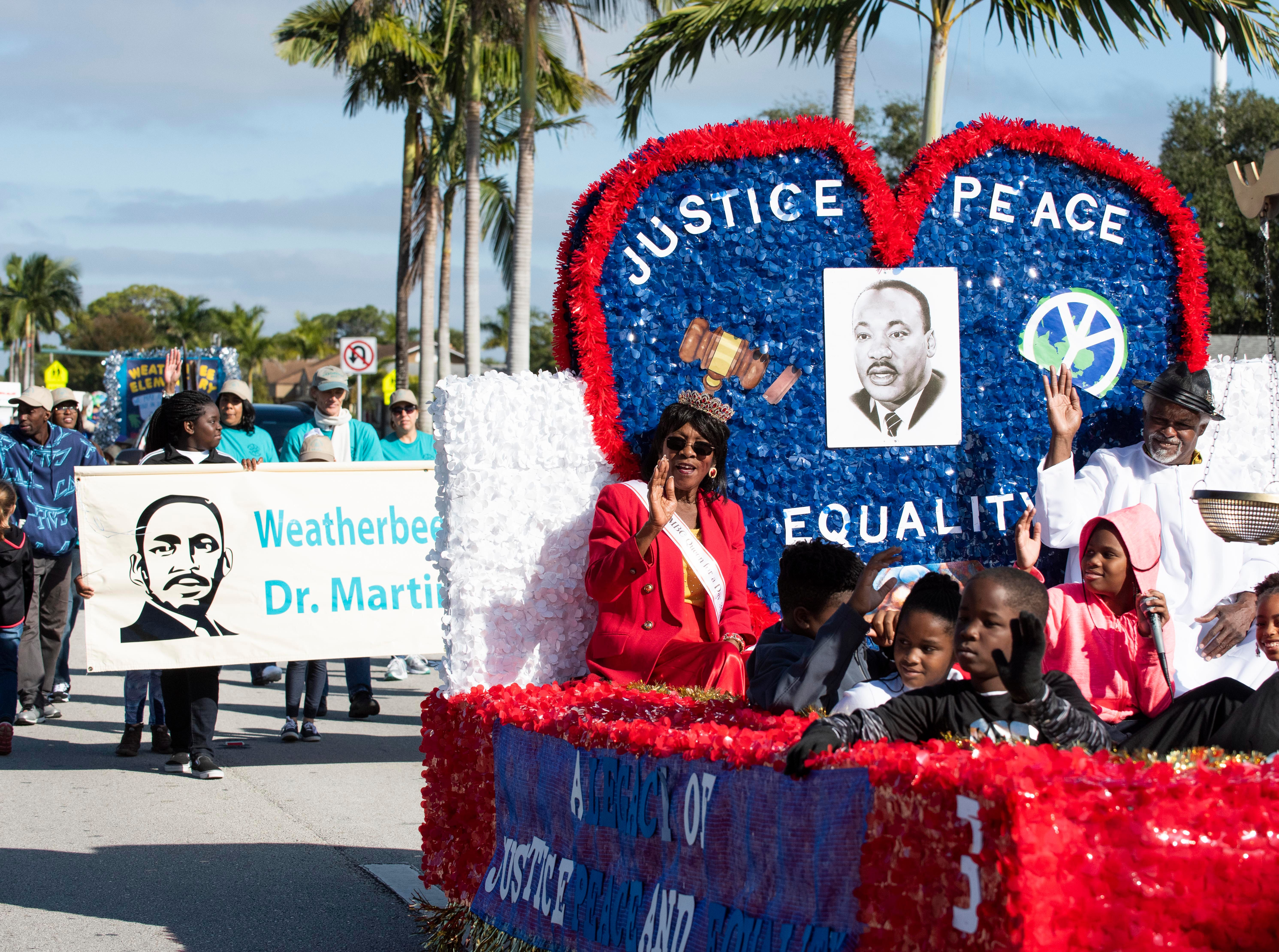 Virginia McMillon (center) celebrates the annual Dr. Martin Luther King Jr. Grand Parade by riding on the Morning Star Missionary Baptist Church float on Monday, Jan. 21, 2019, in Fort Pierce. The parade began at Avenue I and Dr. Martin Luther King Boulevard and ended at Lawnwood Stadium.