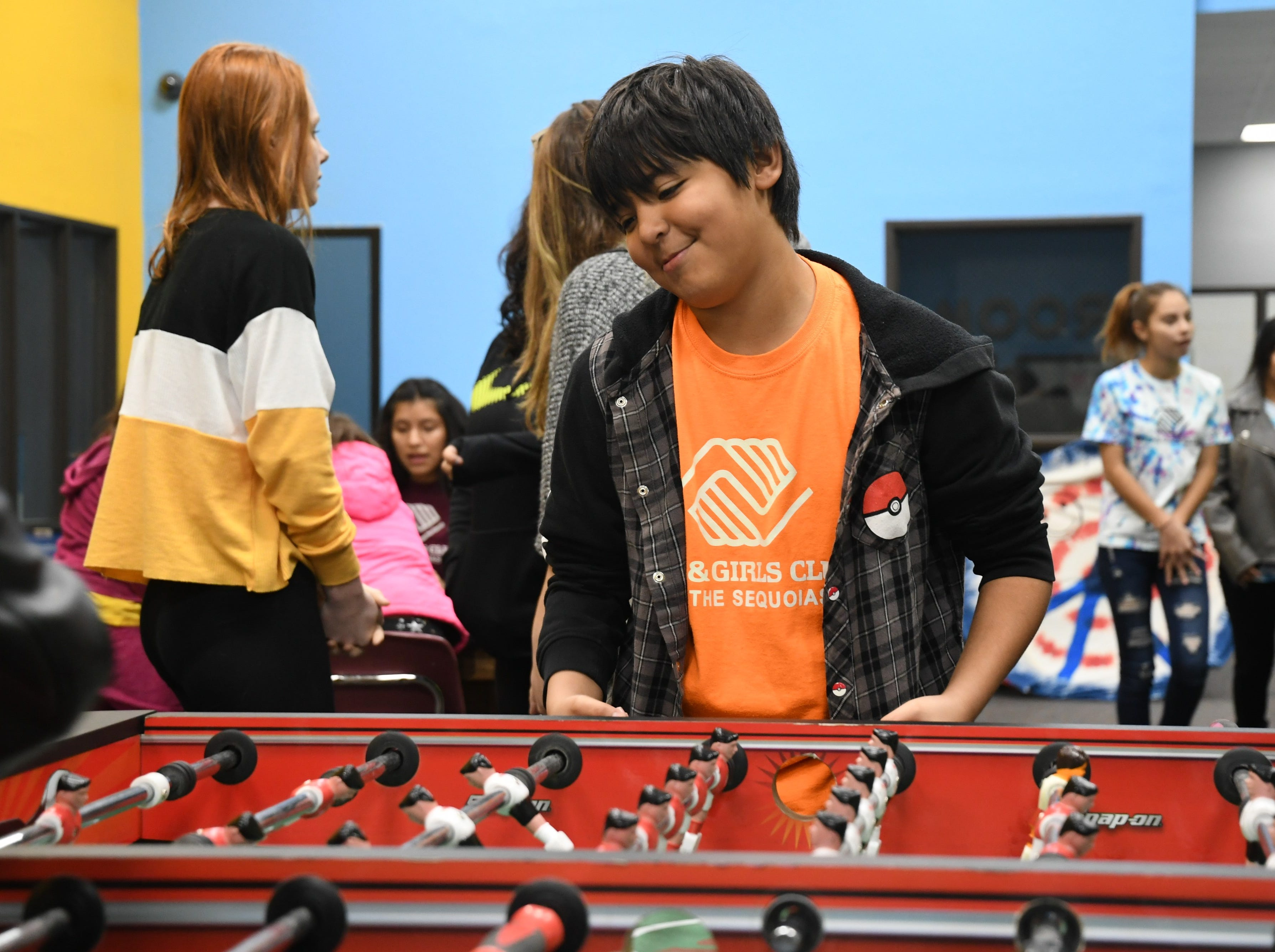 Boys and Girls Club members play at the Visalia center before marching in recognition of MLK's legacy.