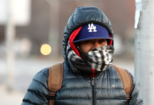 Jorge Cacares of Sleepy Hollow is all bundled up as he walks to the Tarrytown train station in freezing temperatures Jan. 21, 2019.