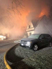 Firefighters battle a three-alarm blaze at 72 Mamaroneck Road in Scarsdale on the morning of Jan. 21, 2019.
