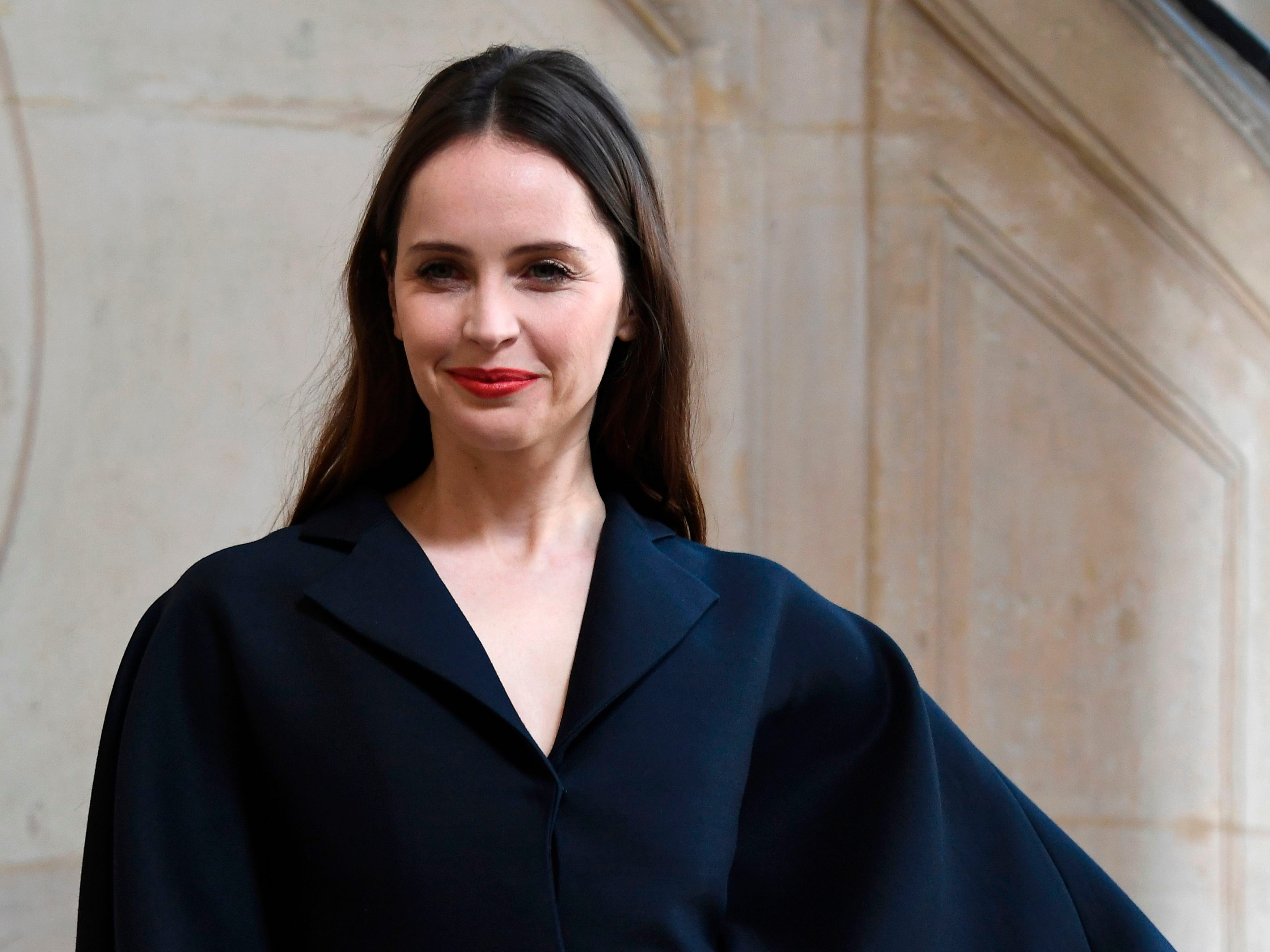 British actress Felicity Jones poses during a photocall prior to the 2019 Spring-Summer Haute Couture collection fashion show by Christian Dior in Paris, on January 21, 2019. (Photo by Anne-Christine POUJOULAT / AFP)ANNE-CHRISTINE POUJOULAT/AFP/Getty Images ORIG FILE ID: AFP_1CG6GG