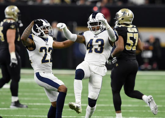 Los Angeles Rams strong safety John Johnson (43) and cornerback Marcus Peters (22) celebrate after an interception against the New Orleans Saints during overtime in the NFC Championship game at Mercedes-Benz Superdome.