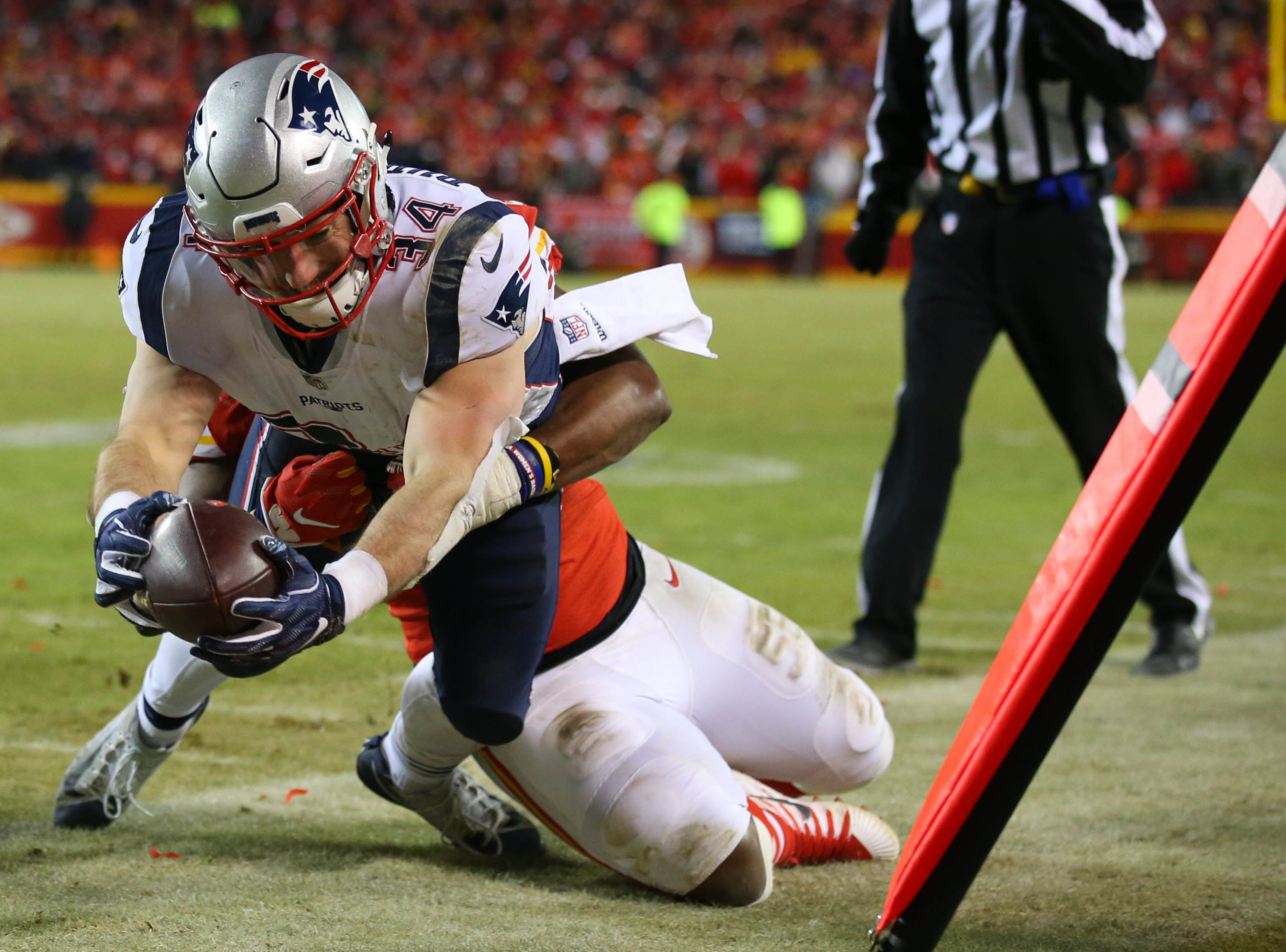 New England Patriots running back Rex Burkhead (34) takes the ball out of bounds during the second half of the AFC Championship Game against the Kansas City Chiefs at Arrowhead Stadium.