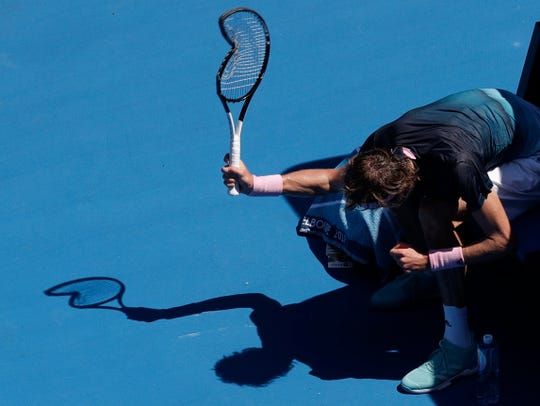 Alexander Zverev smashes his racket during his fourth-round match against Milos Raonic at the Australian Open.