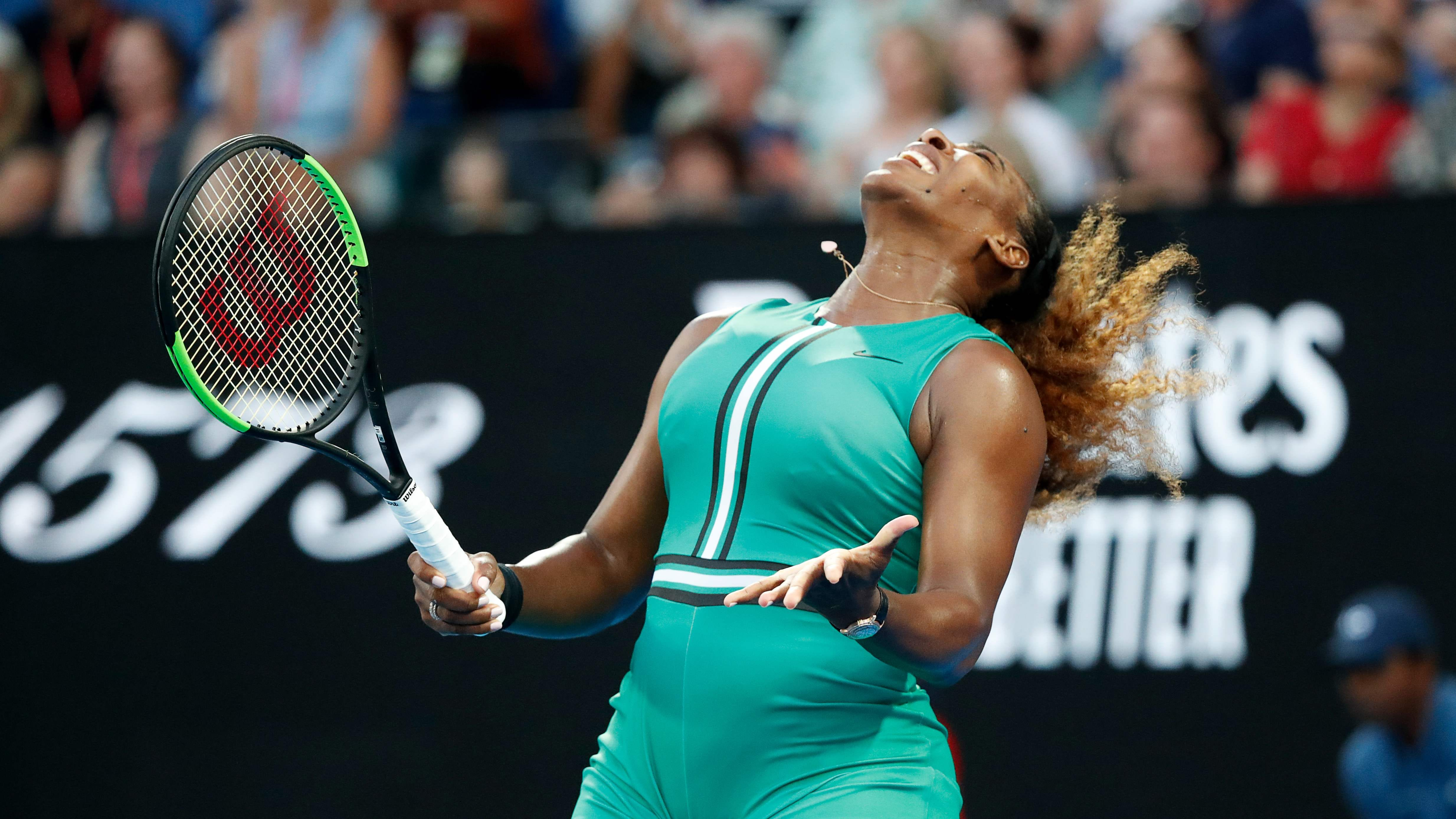 Serena Williams reacts after a point against Romania's Simona Halep during their women's singles match at the Australian Open on Jan. 21.