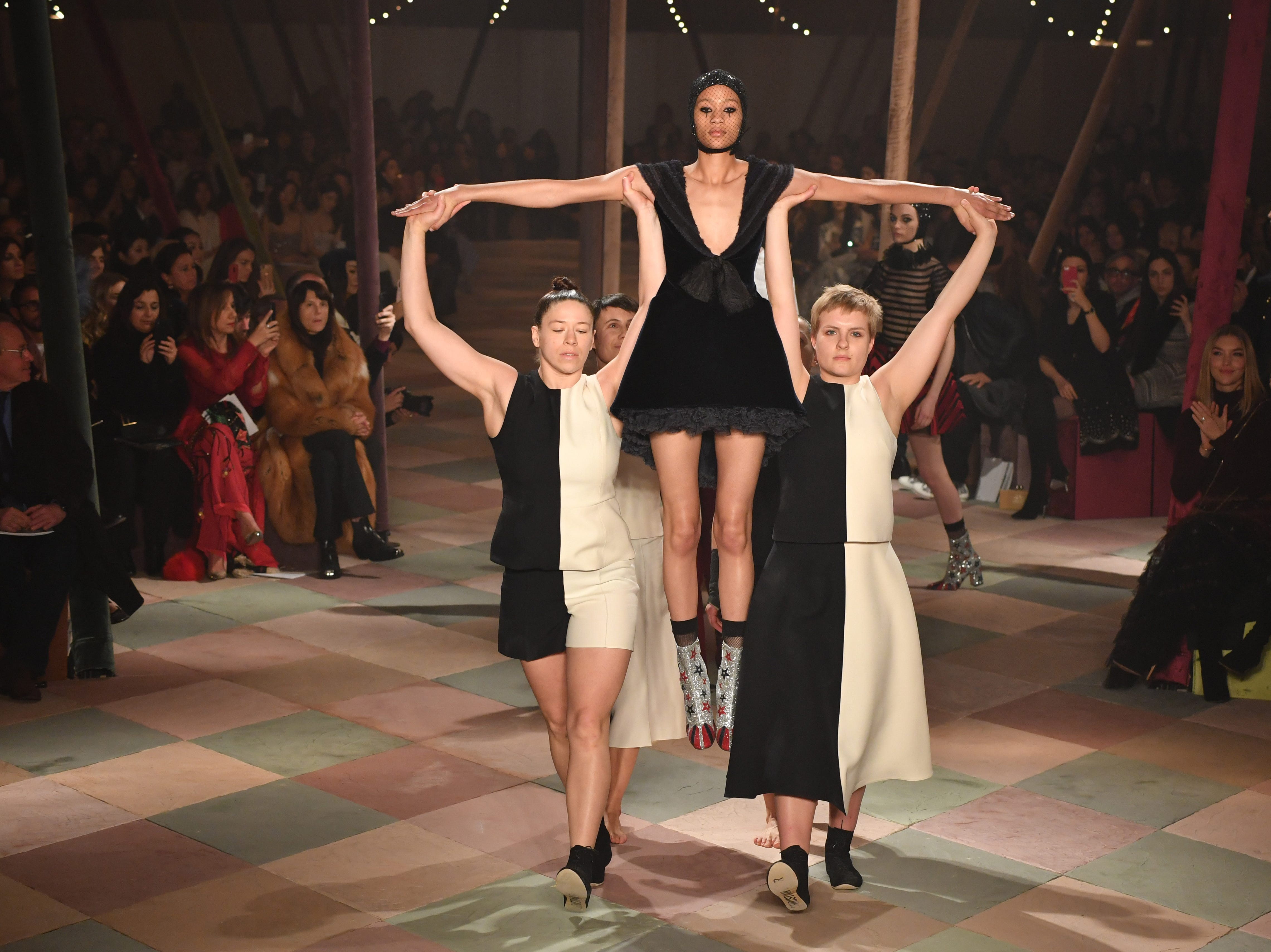 PARIS, FRANCE - JANUARY 21: A model with performers on the runway during the Christian Dior Spring Summer 2019 show as part of Paris Fashion Week on January 21, 2019 in Paris, France. (Photo by Pascal Le Segretain/Getty Images) ORG XMIT: 775271695 ORIG FILE ID: 1097431800