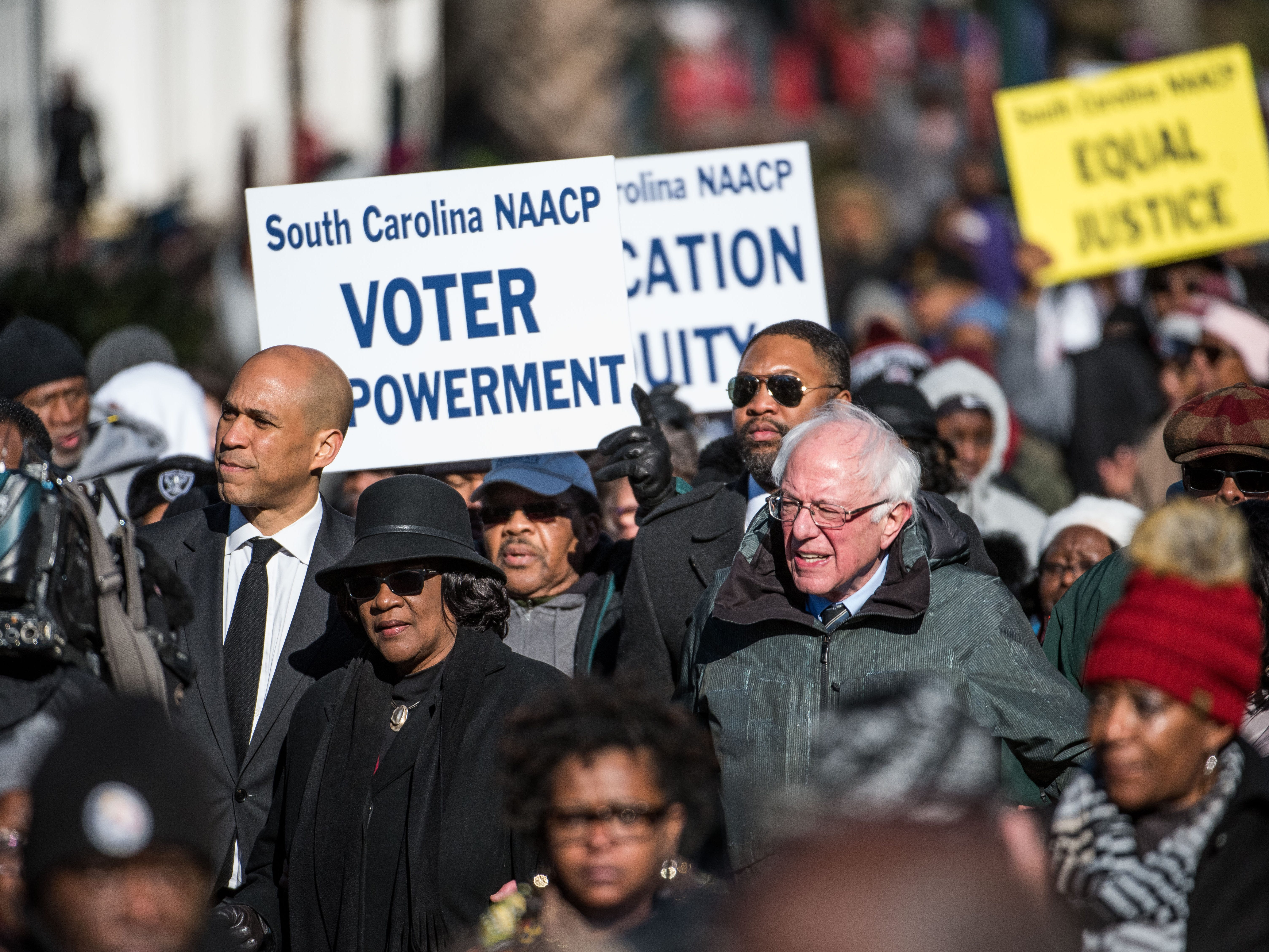 Sen. Bernie Sanders, President of the South Carolina NAACP chapter, Brenda Murphy and Sen. Cory Booker march down Main St. to the Statehouse in commemoration of Martin Luther King Jr. Day in Columbia, So.C.