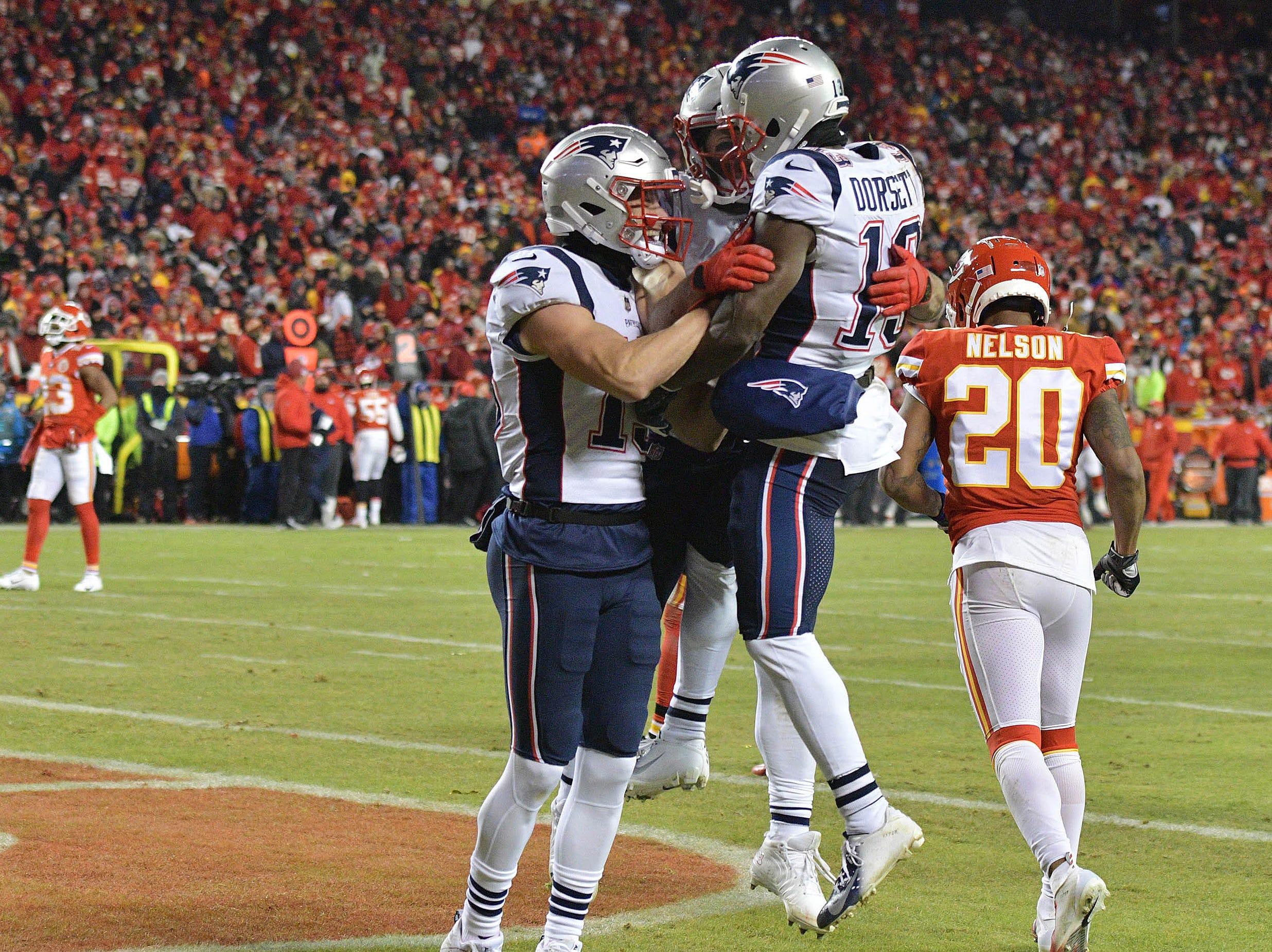 New England Patriots wide receiver Phillip Dorsett (13) celebrates with teammates after scoring a touchdown during the second quarter of the AFC Championship Game against the Kansas City Chiefs.