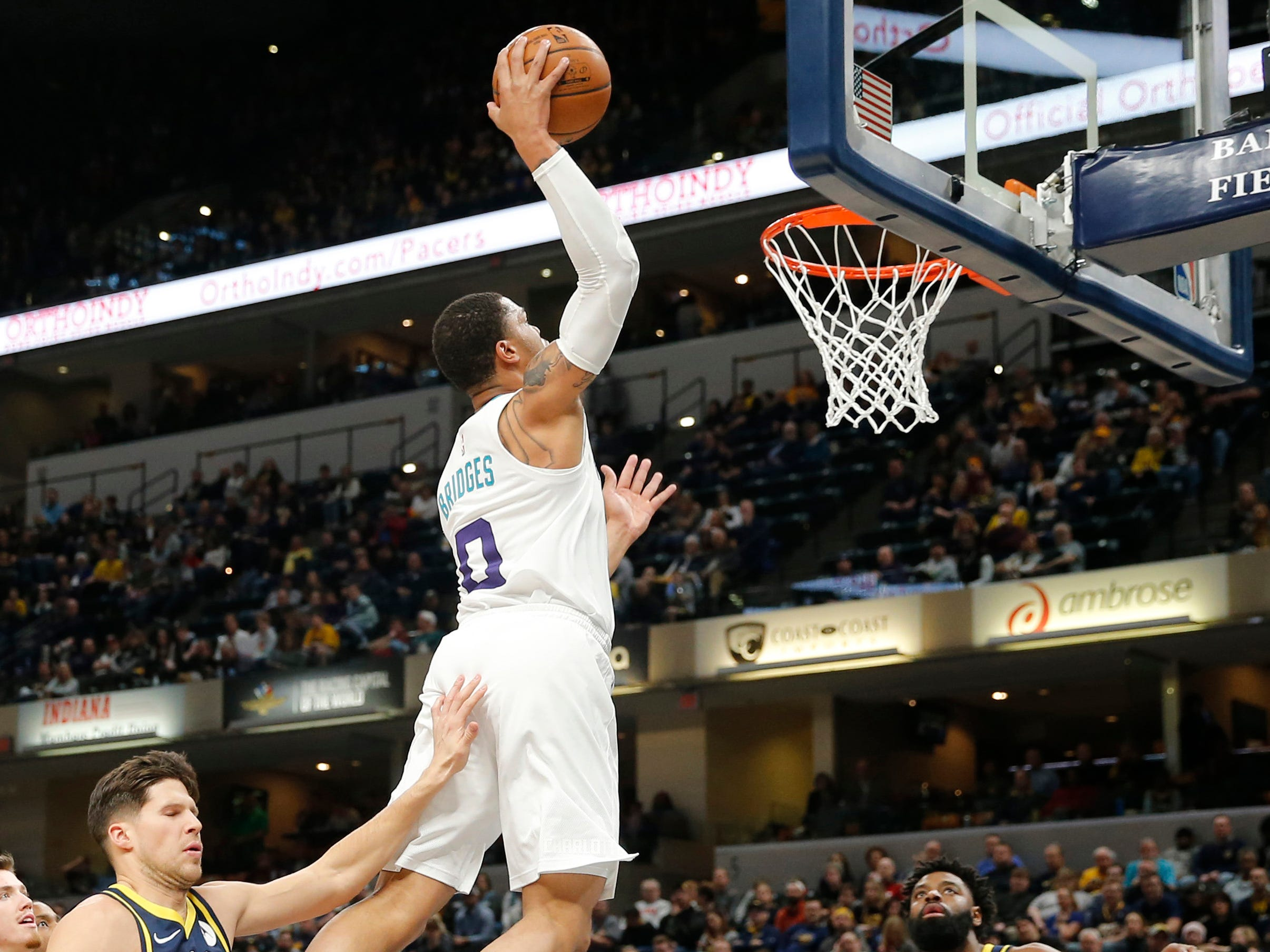 Jan. 20: Hornets forward Miles Bridges rises up for the one-handed slam against the Pacers in Indianapolis.