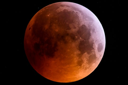 The super blood wolf moon is seen during a total lunar eclipse near Salgotarjan, northeast of Budapest, Hungary.