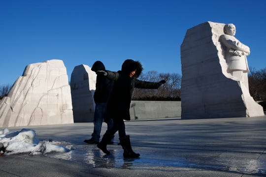 Daniela Fuentes,9, skates on ice as she and her family brave frigid temperatures to visit the Martin Luther King, Jr. Memorial on MLK Day, in Washington.