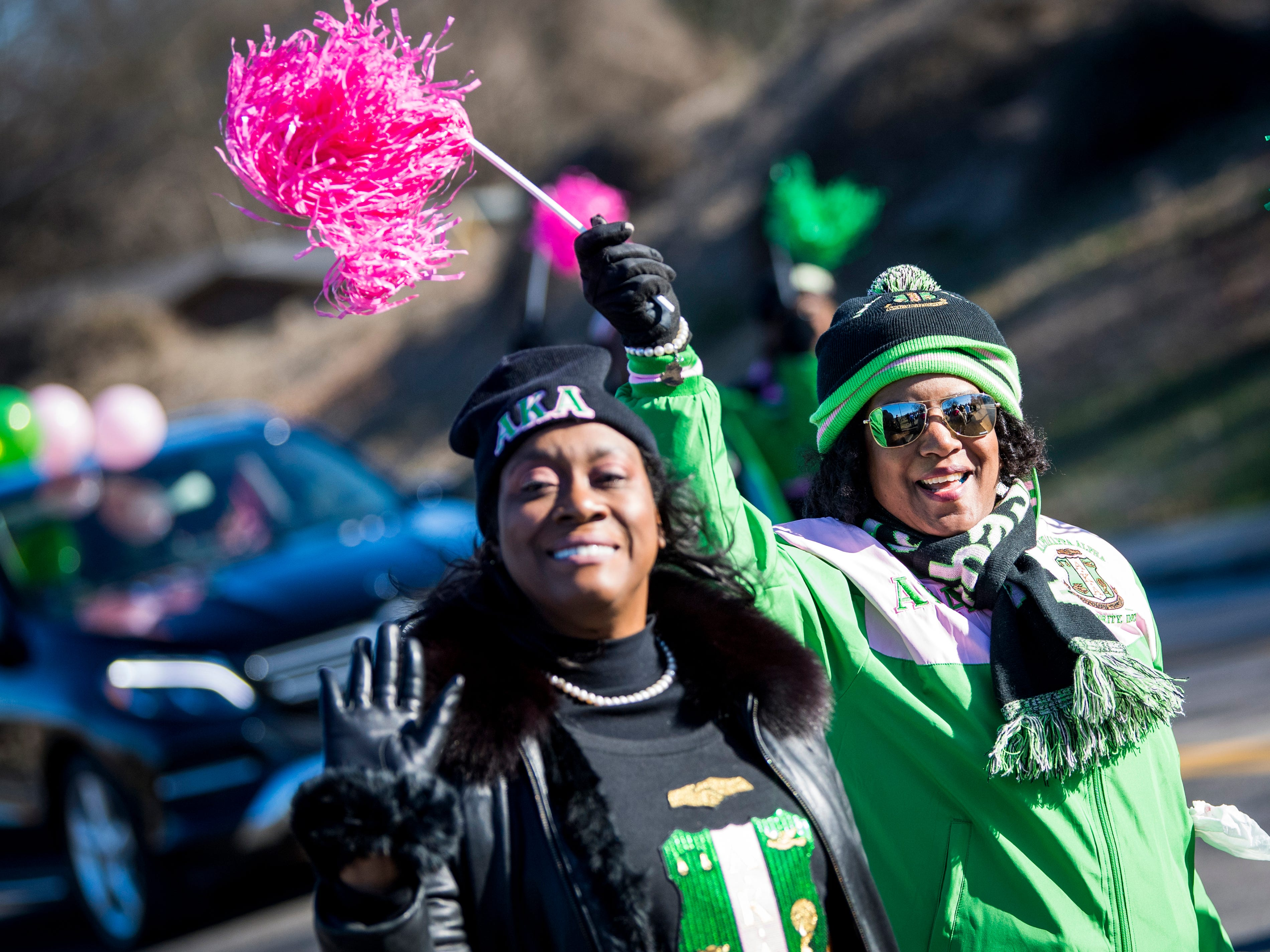 Alpha Kappa Alpha sorority sisters wave to the crowd as the annual MLK Memorial Parade parades down Martin Luther King Jr. Avenue in Knoxville, Tenn..
