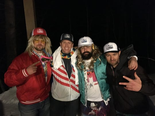 Will Novak, in the red and white jacket, attended a stranger's bachelor party in Vermont after being accidentally invited. The groom to be, Angelo, is on the far right.