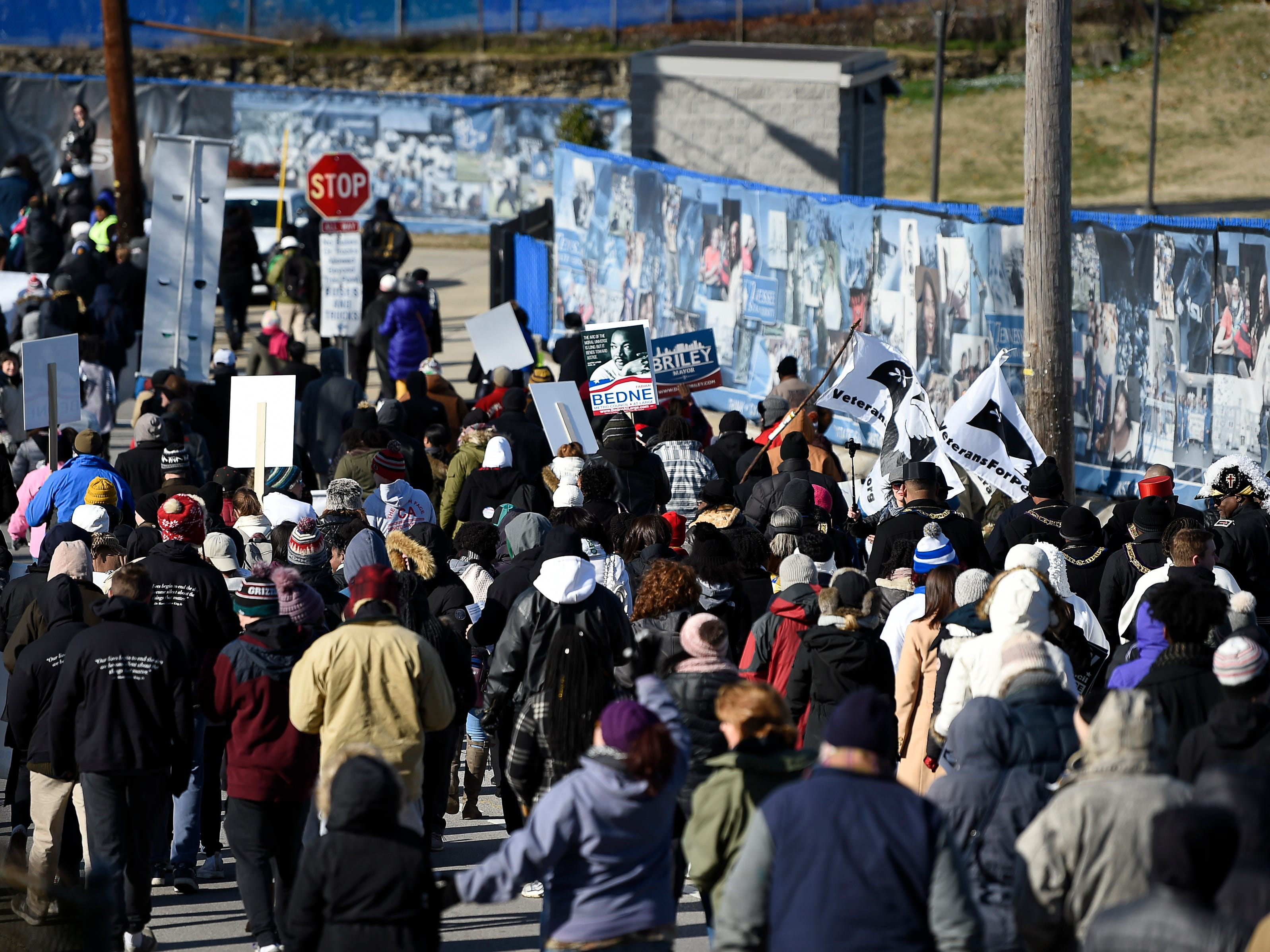 Marchers make their way up John Merritt Blvd. during the Martin Luther King Day March in Nashville.
