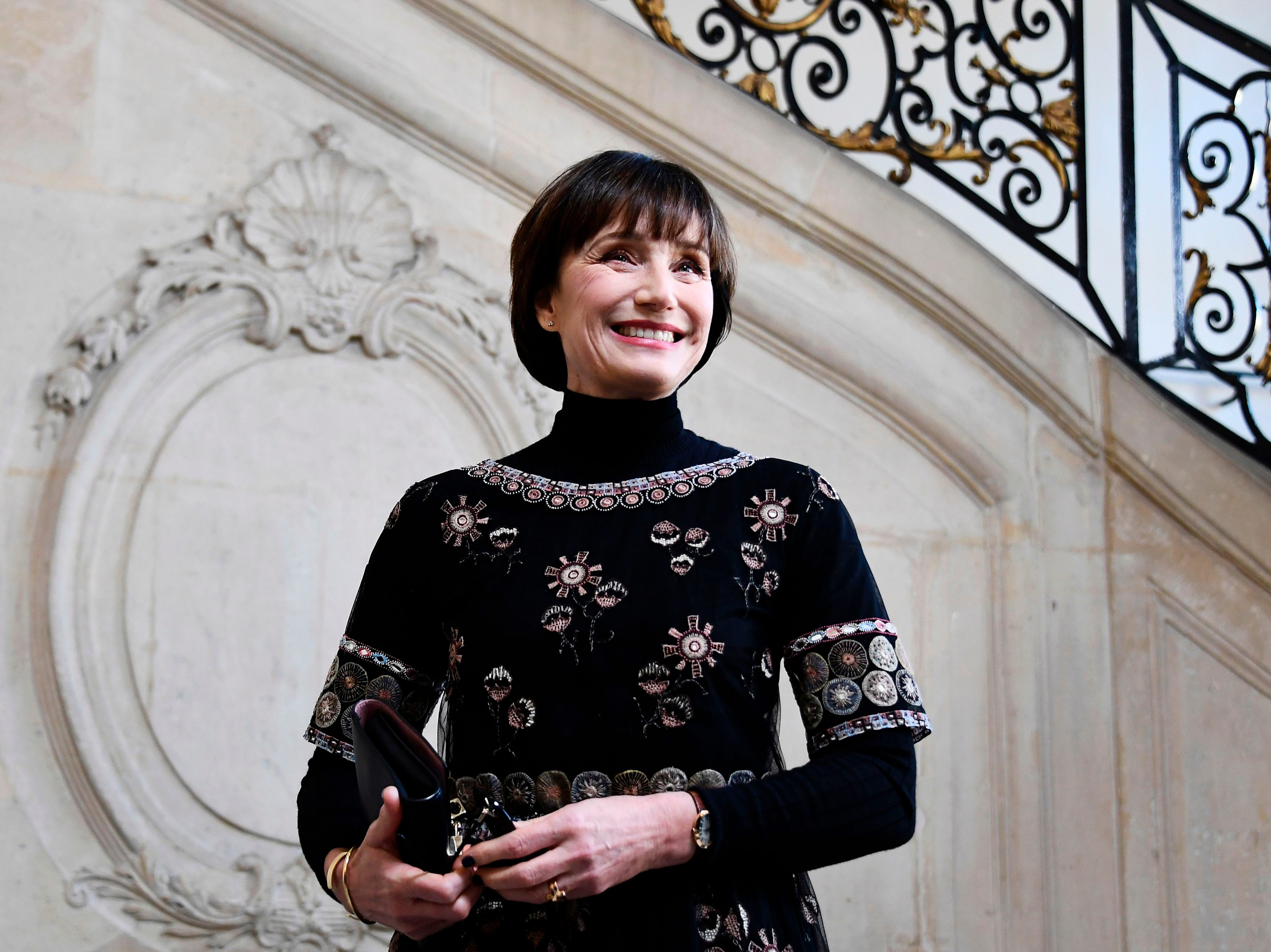 TOPSHOT - British actress Kristin Scott Thomas poses during a photocall prior to the 2019 Spring-Summer Haute Couture collection fashion show by Christian Dior in Paris, on January 21, 2019. (Photo by Anne-Christine POUJOULAT / AFP)ANNE-CHRISTINE POUJOULAT/AFP/Getty Images ORIG FILE ID: AFP_1CG6I3