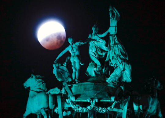 A view of the lunar eclipse pictured in Jubilee Park, in Brussels, Belgium.
