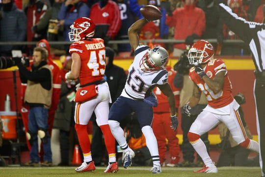 New England Patriots wide receiver Phillip Dorsett (13) celebrates after catching a touchdown pass in front of Kansas City Chiefs cornerback Steven Nelson (20) during the first half of the AFC Championship game at Arrowhead Stadium.