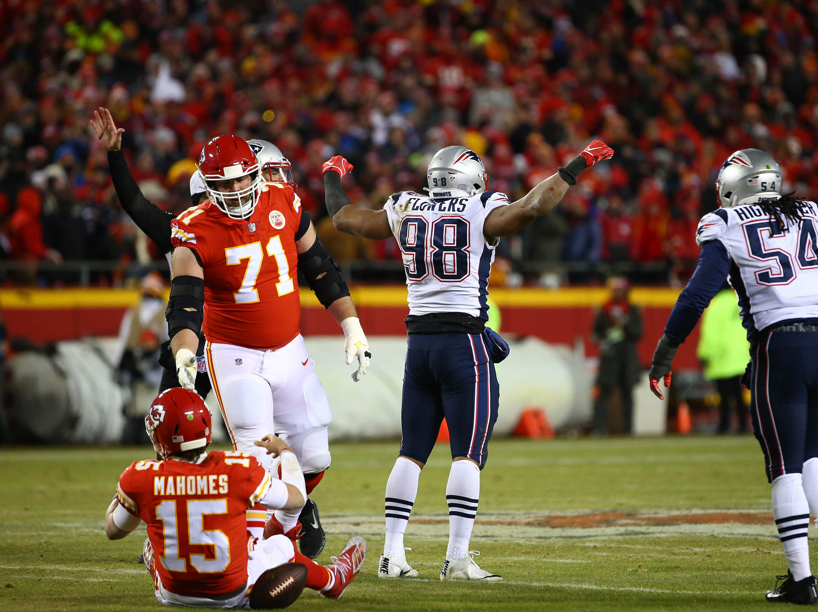 New England Patriots defensive end Trey Flowers (98) reacts after sacking Kansas City Chiefs quarterback Patrick Mahomes (15) during the first half.