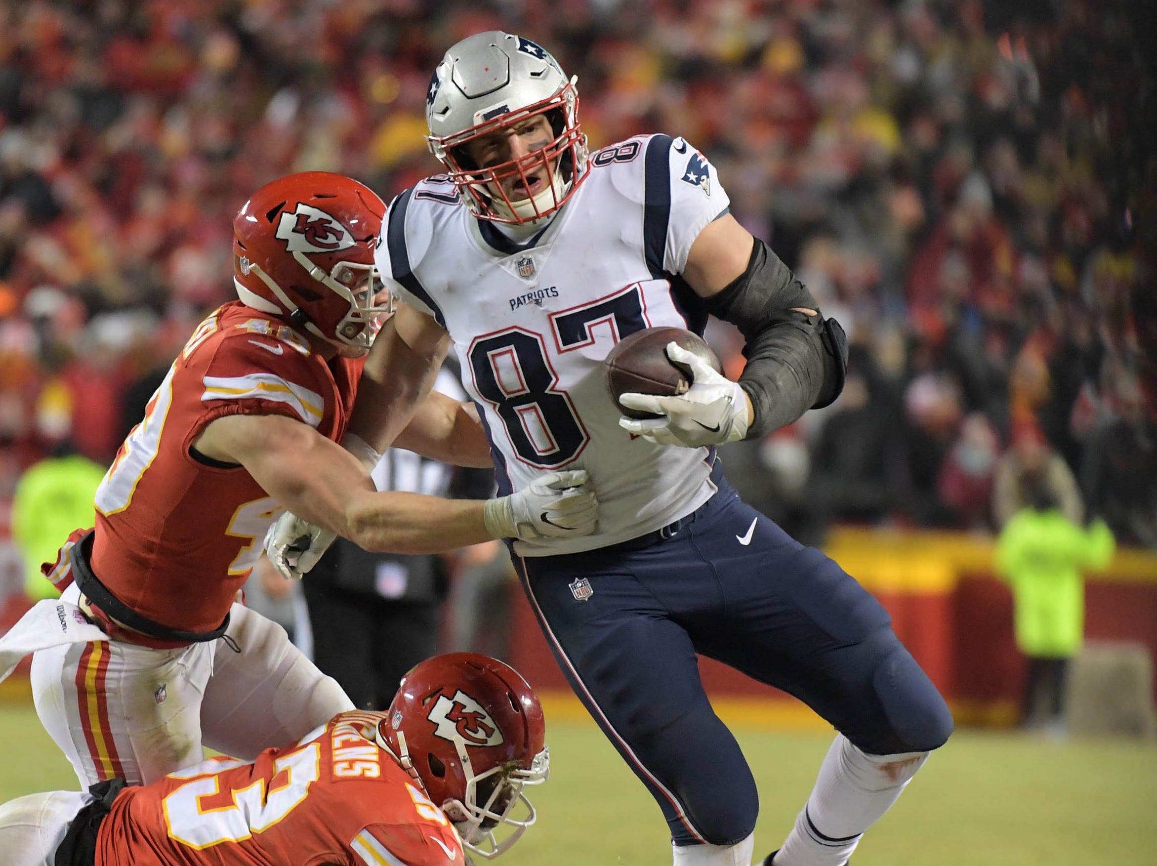 New England Patriots tight end Rob Gronkowski (87) runs with the ball during the second half of the AFC Championship Game at Arrowhead Stadium.