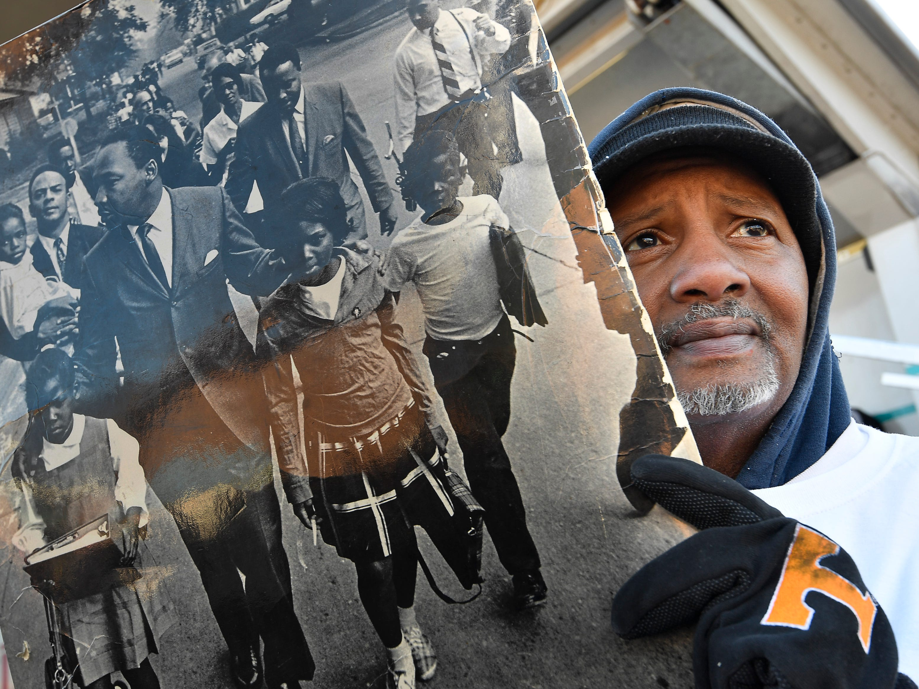 Kenny Covington holds a picture of Dr. King at Martin Luther King Day March in Nashville, Tenn.
