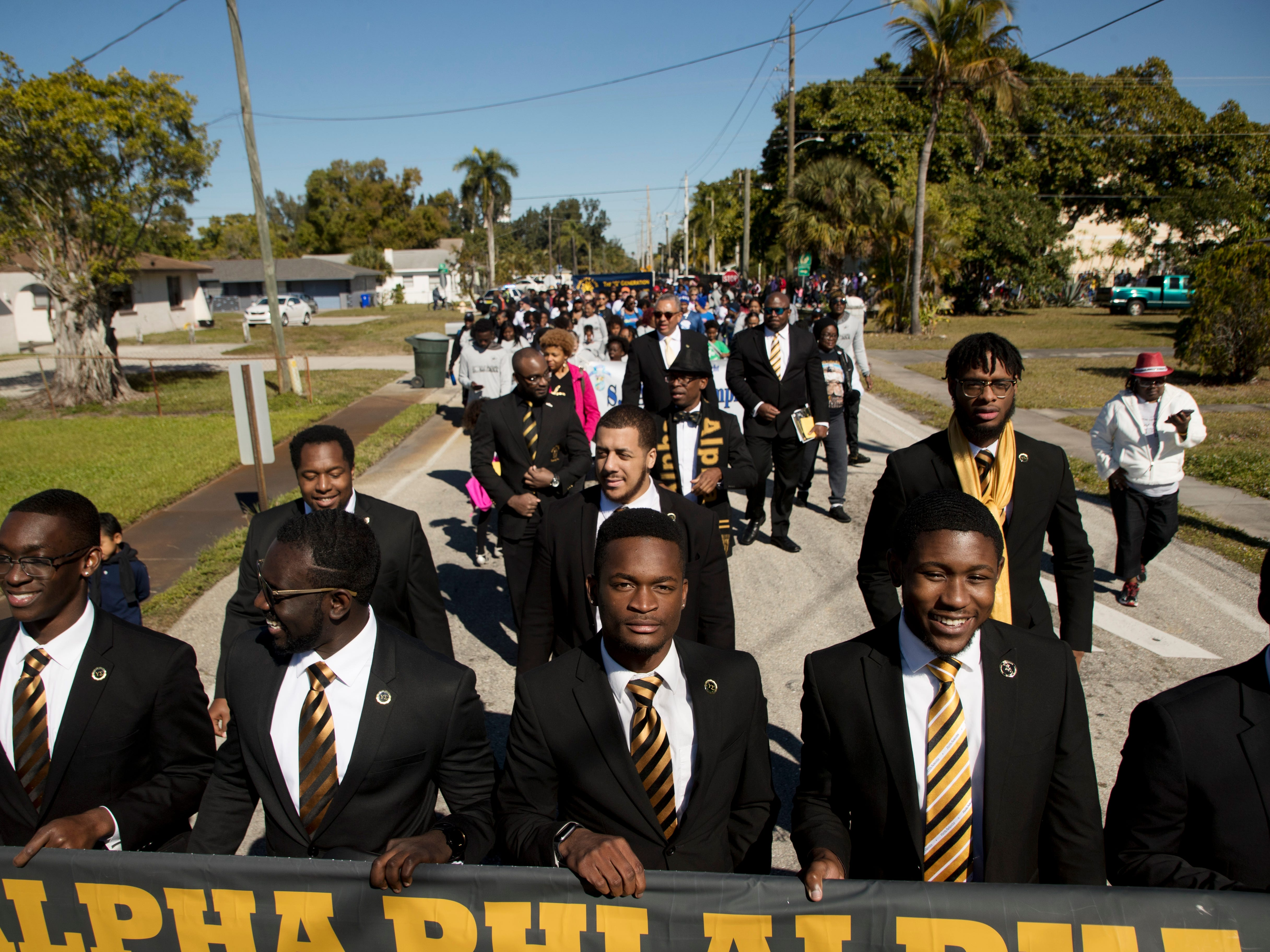 Members of the Alpha Phi Alpha Fraternity lead the annual Martin Luther King Jr. Commemorative March in Fort Myers, Fla.
