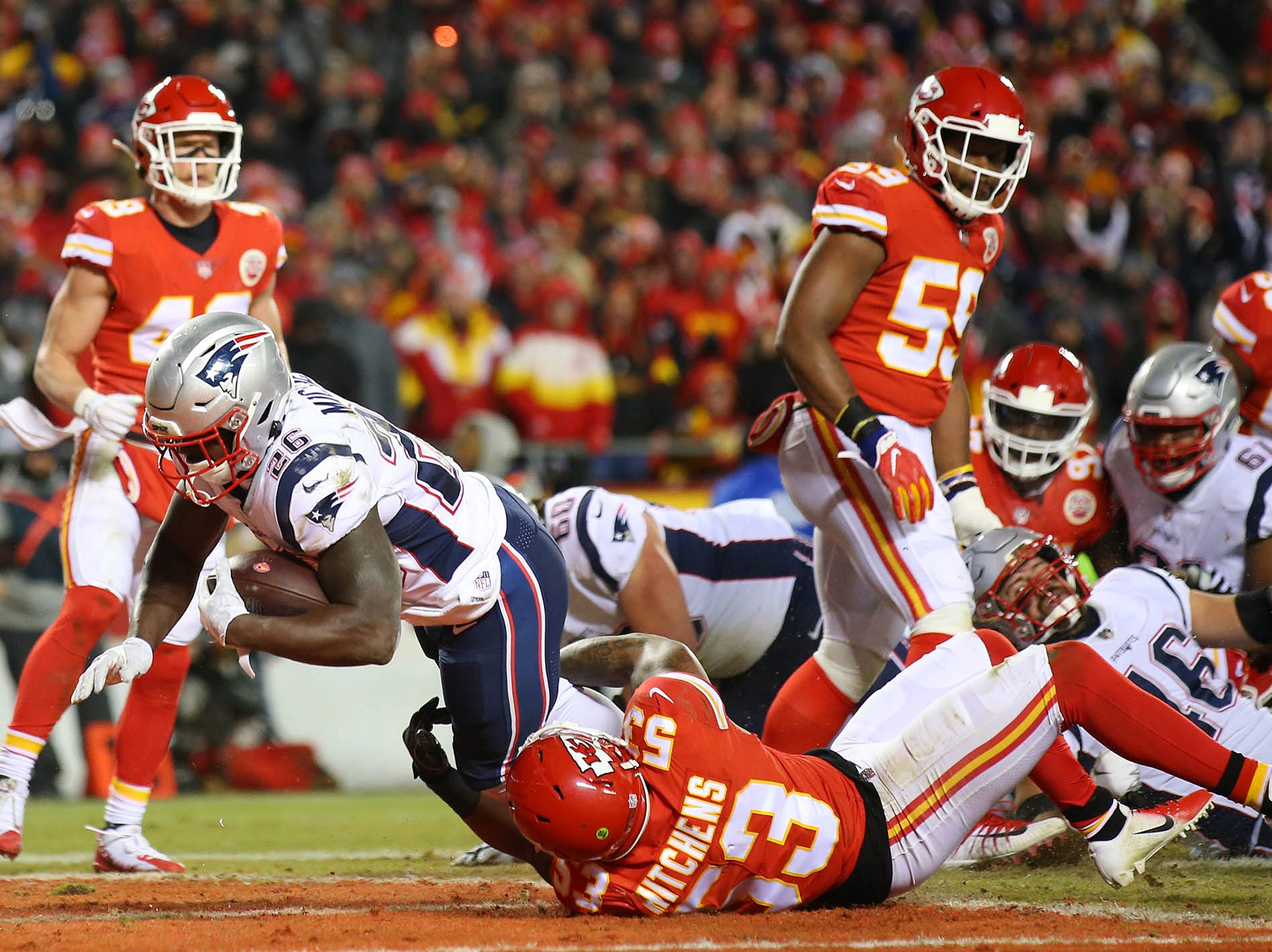 New England Patriots running back Sony Michel (26) scores a touchdown against the Kansas City Chiefs during the first quarter of the AFC Championship Game at Arrowhead Stadium.