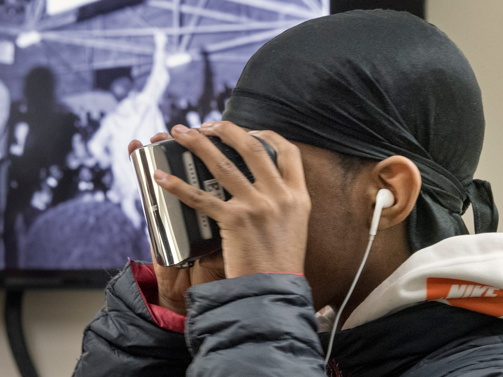 Jyasiere Brown watches a program about the life of Martin Luther King Jr. with virtual reality glasses at the 37th Annual MLK Day of Service at the Crispus Attucks Community Association in York, PA.