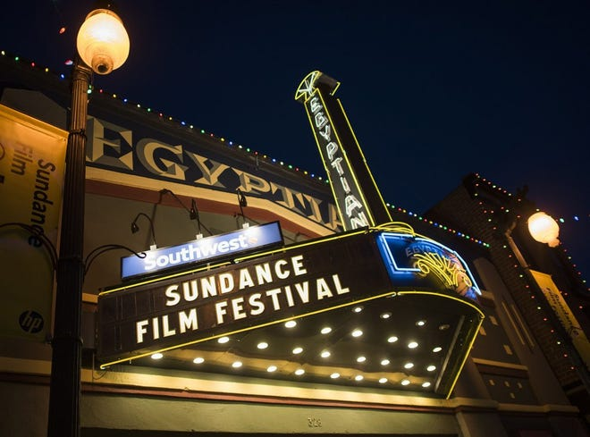 In this Thursday, Jan. 22, 2015, file photo, the Egyptian Theatre is lit up on Main Street during the first night of the Sundance Film Festival in Park City, Utah. The mountainside festival, which kicks off Thursday, Jan. 24, 2019, in Park City, Utah, has become known for launching nonfiction films to box office successes and awards, and this year is shaping up to be no different.