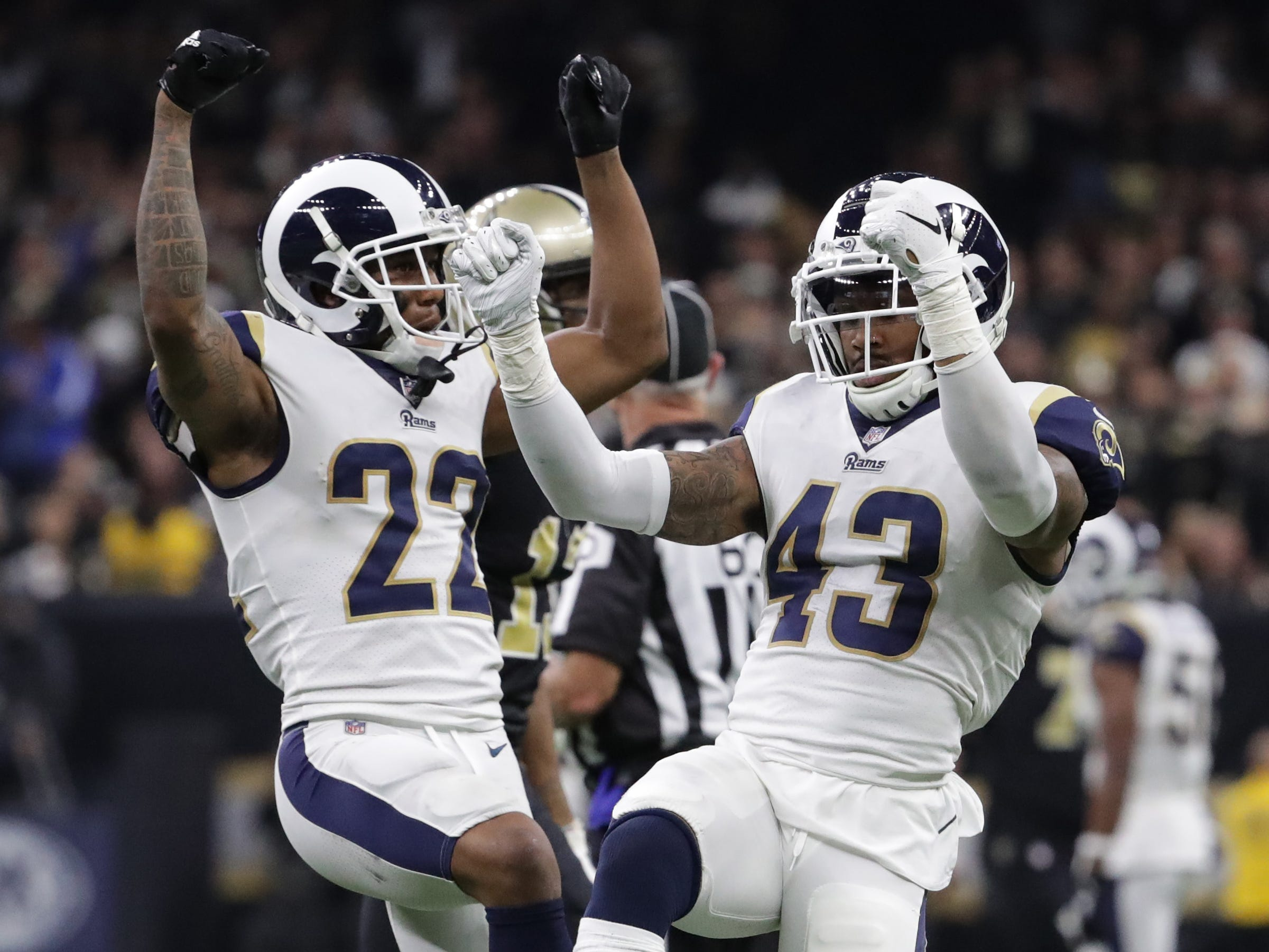 Los Angeles Rams cornerback Marcus Peters (22) and strong safety John Johnson (43) celebrate an interception during overtime in the NFC Championship at Mercedes-Benz Superdome.