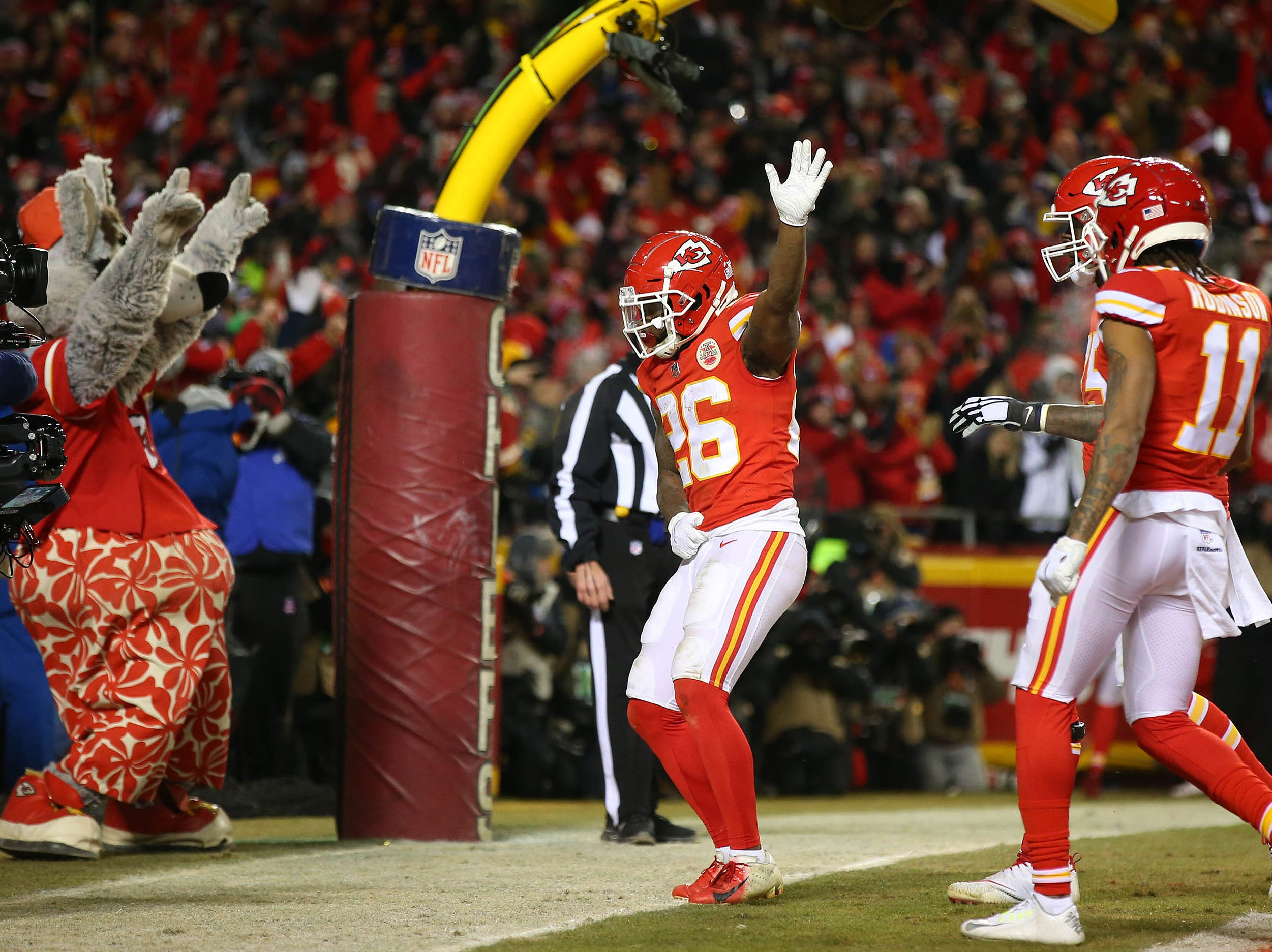 Kansas City Chiefs running back Damien Williams (26) celebrates after scoring a touchdown against the New England Patriots during the second half of the AFC Championship Game at Arrowhead Stadium.