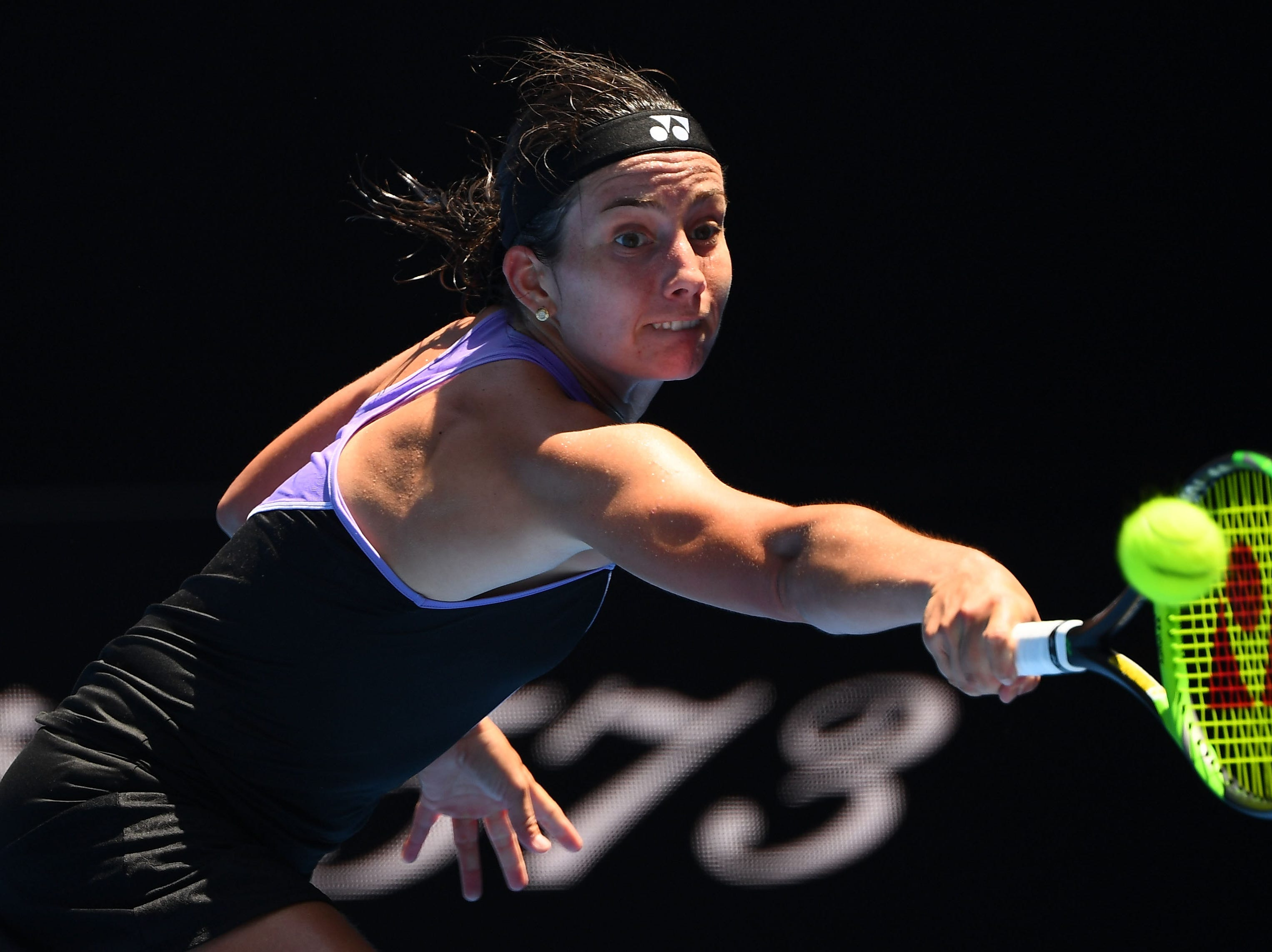 Anastasija Sevastova of Latvia stretches for a backhand during her Round of 16 match against Japan's Naomi Osaka.