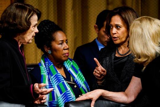 Left to right, Sen. Dianne Feinstein, D-Calif., ranking member, Sheila Jackson Lee, D-Texas, Sen. Kamala D. Harris, D-Calif., speak before a Senate Judiciary Committee hearing on Sept.27, 2018.