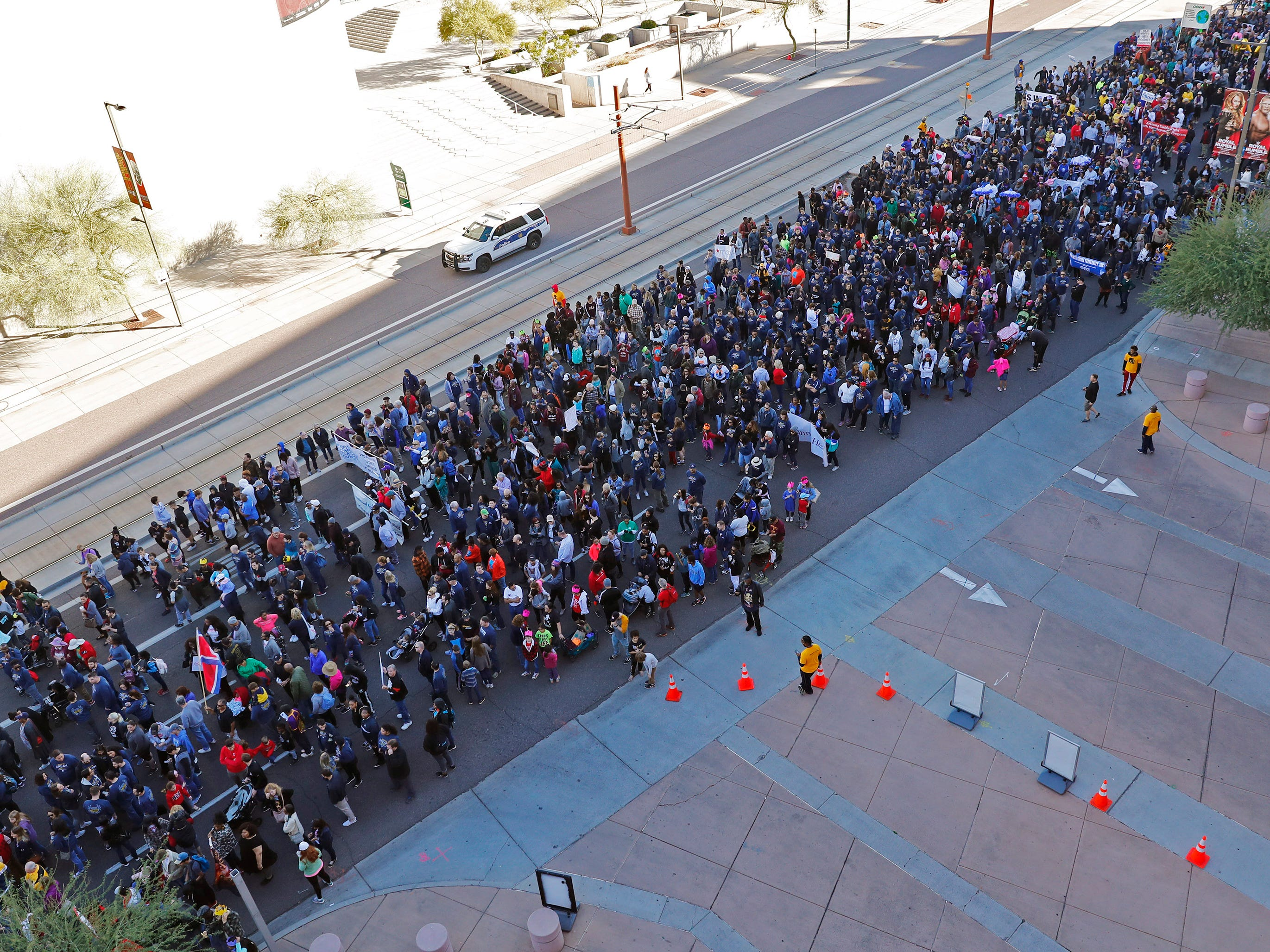 Thousands of people march honoring Dr. Martin Luther King in downtown Phoenix, AZ.