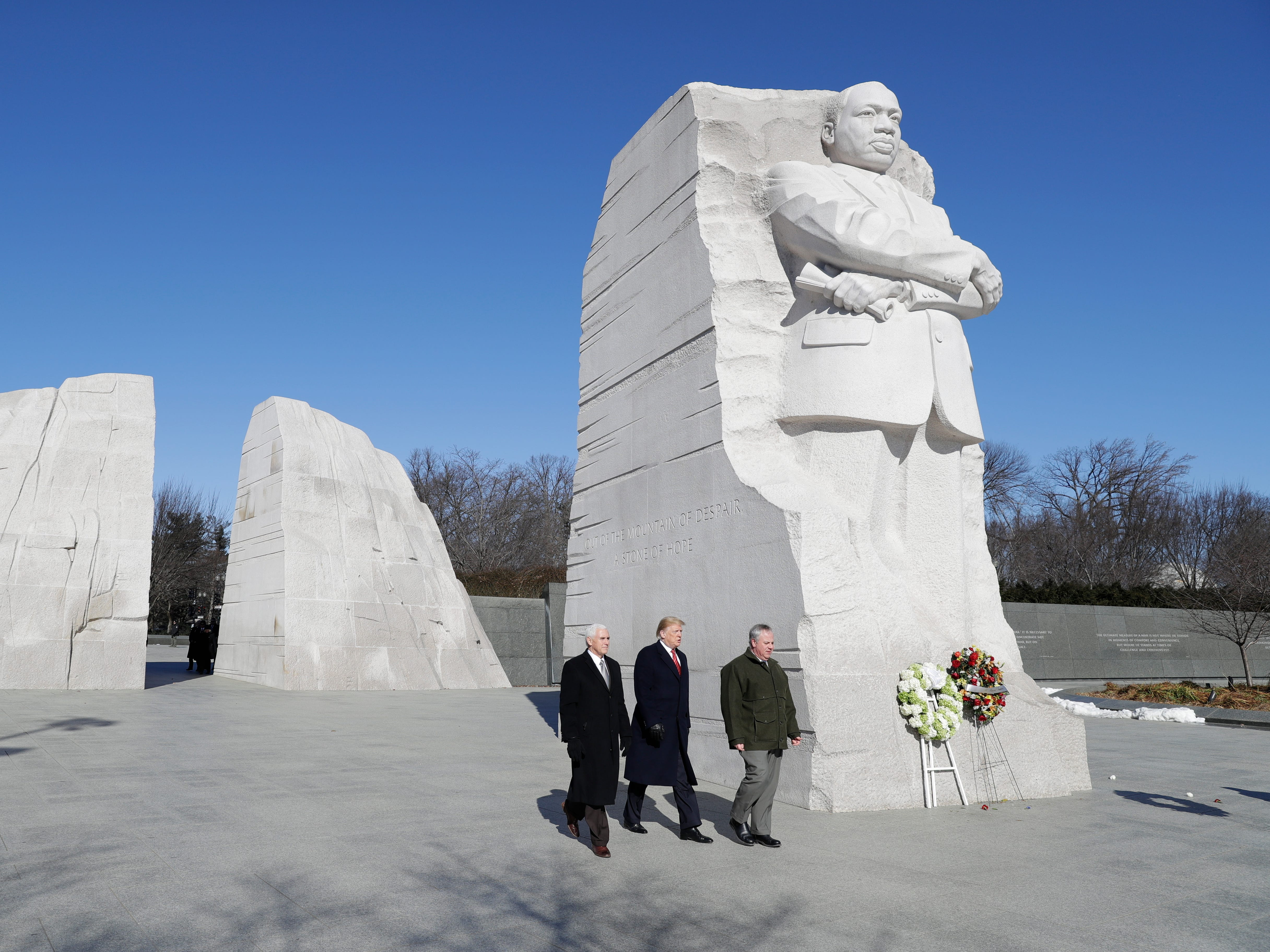 President Donald Trump, Vice President Mike Pence are escorted by Acting Interior Secretary David Bernhardt as they visit the Martin Luther King Jr. in Washington.