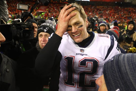 New England Patriots quarterback Tom Brady (12) reacts after defeating the Kansas City Chiefs during overtime in the AFC Championship game at Arrowhead Stadium.
